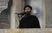 "An image grab taken from a propaganda video released on July 5, 2014 by al-Furqan Media allegedly shows the leader of the Islamic State (IS) jihadist group, Abu Bakr al-Baghdadi, aka Caliph Ibrahim, adressing Muslim worshippers at a mosque in the militant-held northern Iraqi city of Mosul. Baghdadi, who on June 29 proclaimed a ""caliphate"" straddling Syria and Iraq, purportedly ordered all Muslims to obey him in the video released on social media. AFP PHOTO / HO / AL-FURQAN MEDIA == RESTRICTED TO EDITORIAL USE - MANDATORY CREDIT ""AFP PHOTO / HO / AL-FURQAN MEDIA "" - NO MARKETING NO ADVERTISING CAMPAIGNS - DISTRIBUTED AS A SERVICE TO CLIENTS FROM ALTERNATIVE SOURCES, AFP IS NOT RESPONSIBLE FOR ANY DIGITAL ALTERATIONS TO THE PICTURE'S EDITORIAL CONTENT, DATE AND LOCATION WHICH CANNOT BE INDEPENDENTLY VERIFIED =="